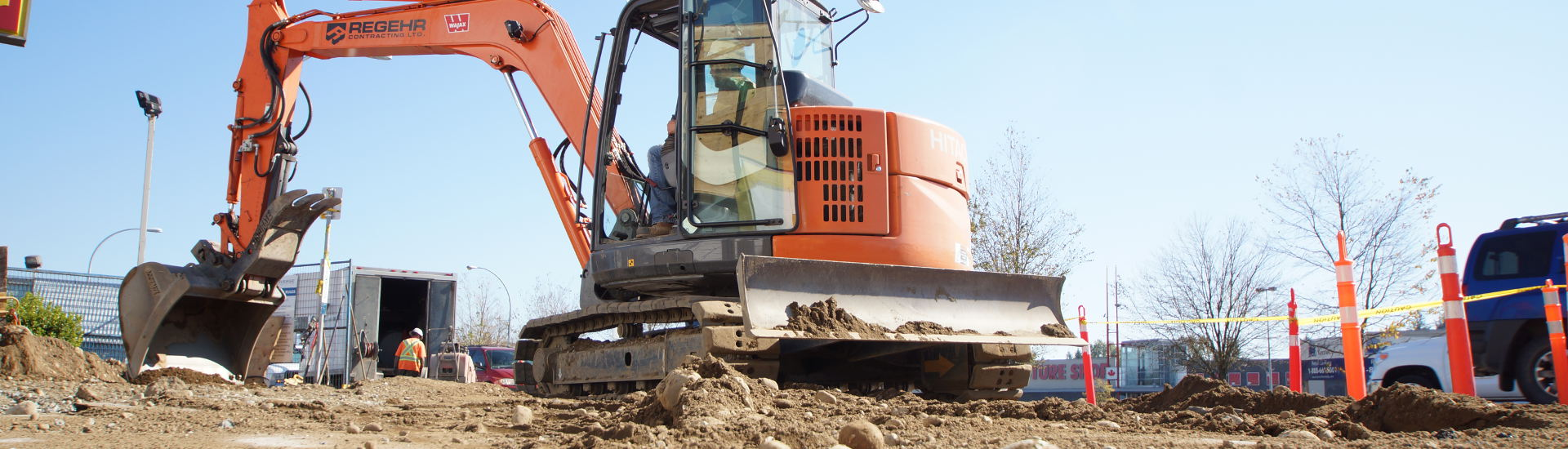 Mini excavator on commercial project